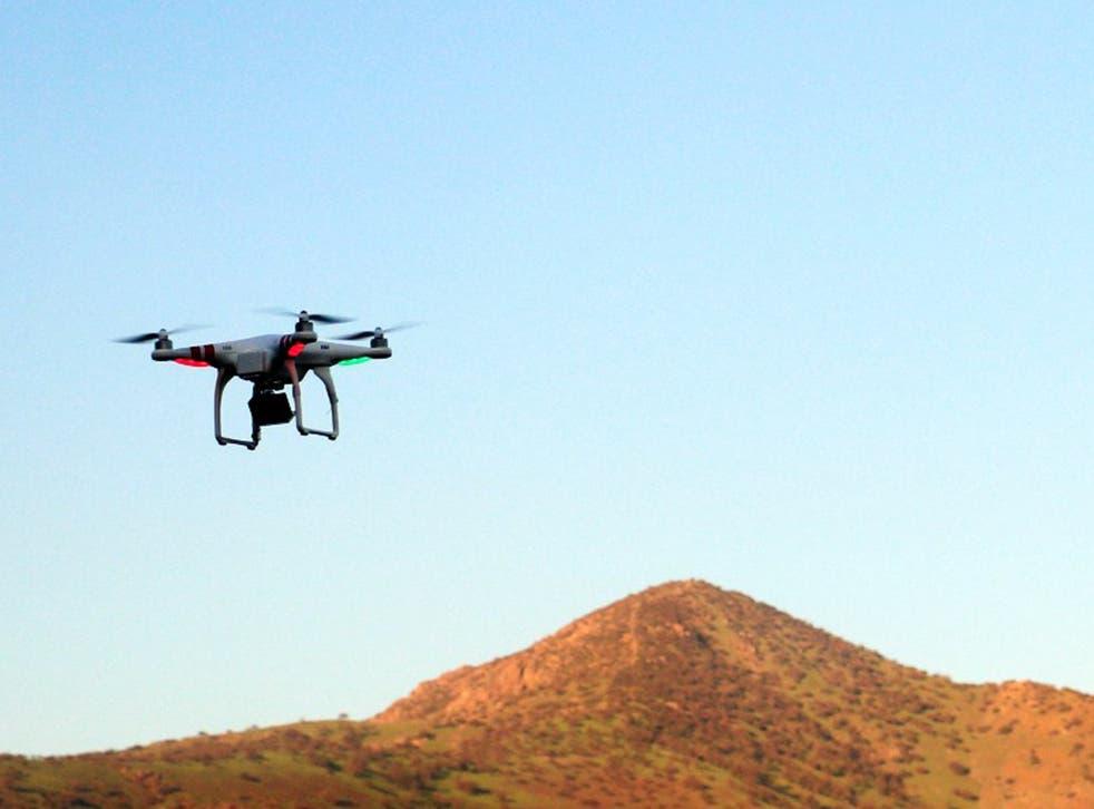 A drone flies in a park of Santiago