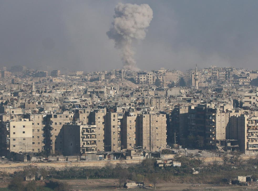 Smoke rises from a rebel-held area of Aleppo, where government forces have been bombing relentlessly over the past month