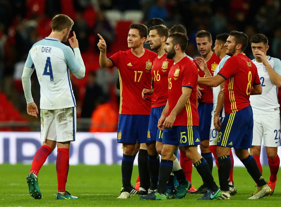 Dier and Herrera square up to one another during last month's international friendly between England and Spain