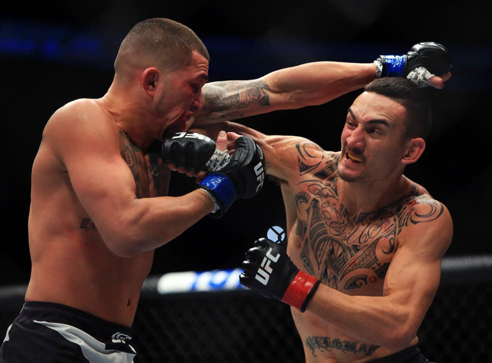 Holloway, right, claimed victory by technical knock-out