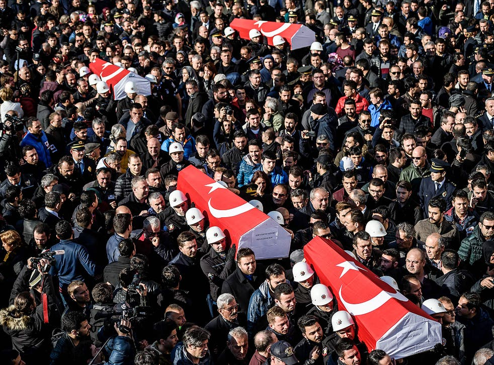 Turkish police officers carry the coffins of comrades during a funeral cerenomy at Istanbul's police headquarters