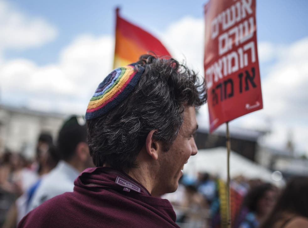 A man wearing a kippah takes part in the annual Pride parade in London