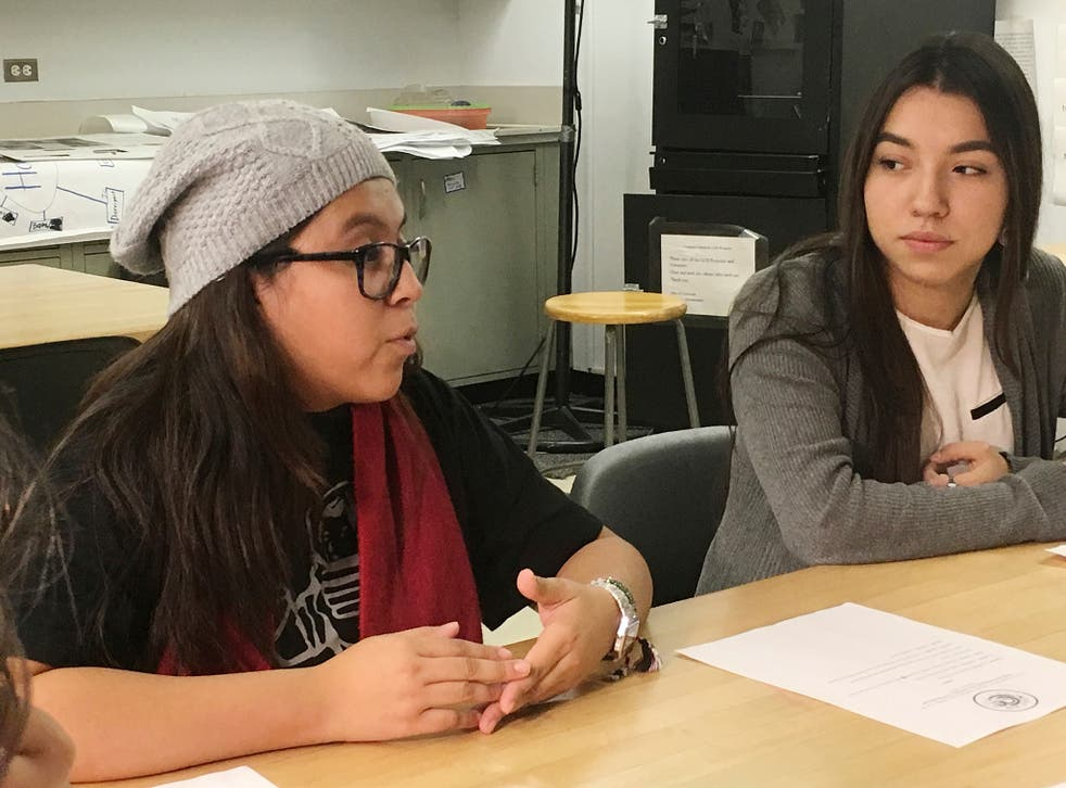 Mexican students Yatziri Tovar, left, and Roxanna Herrera, discuss their travel plans at City College of New York