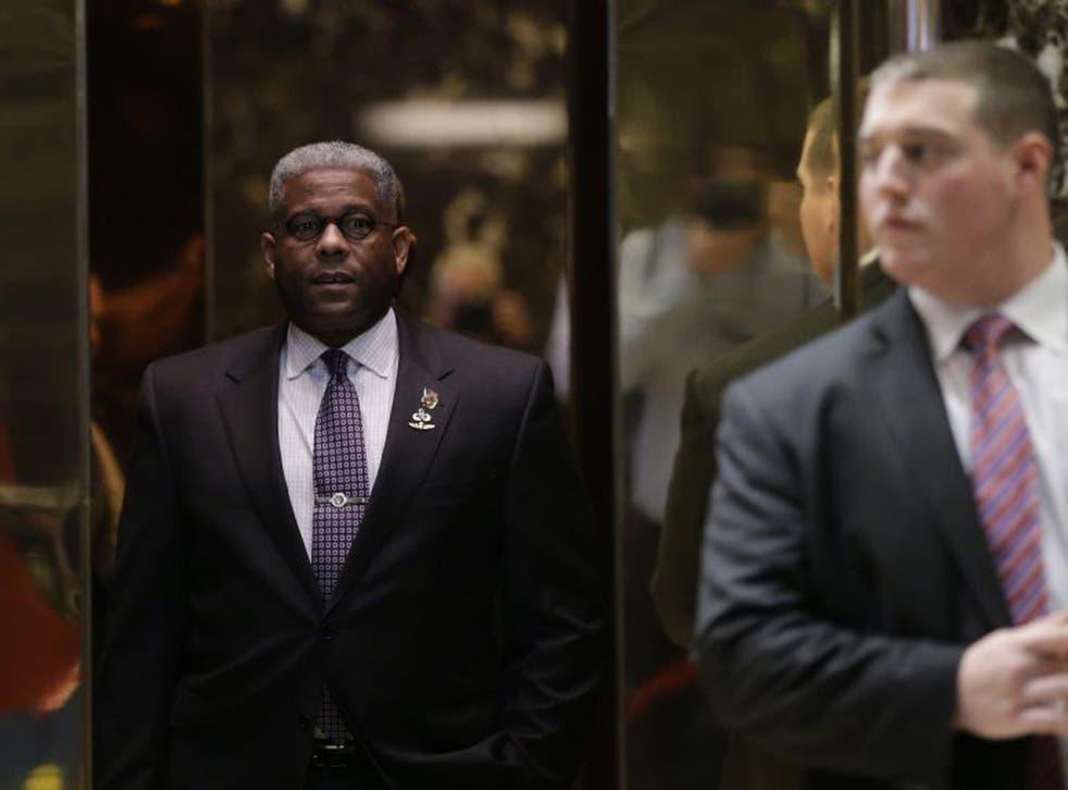 Former US Representative Allen West stands in an elevator as he arrives at Trump Tower in New York City