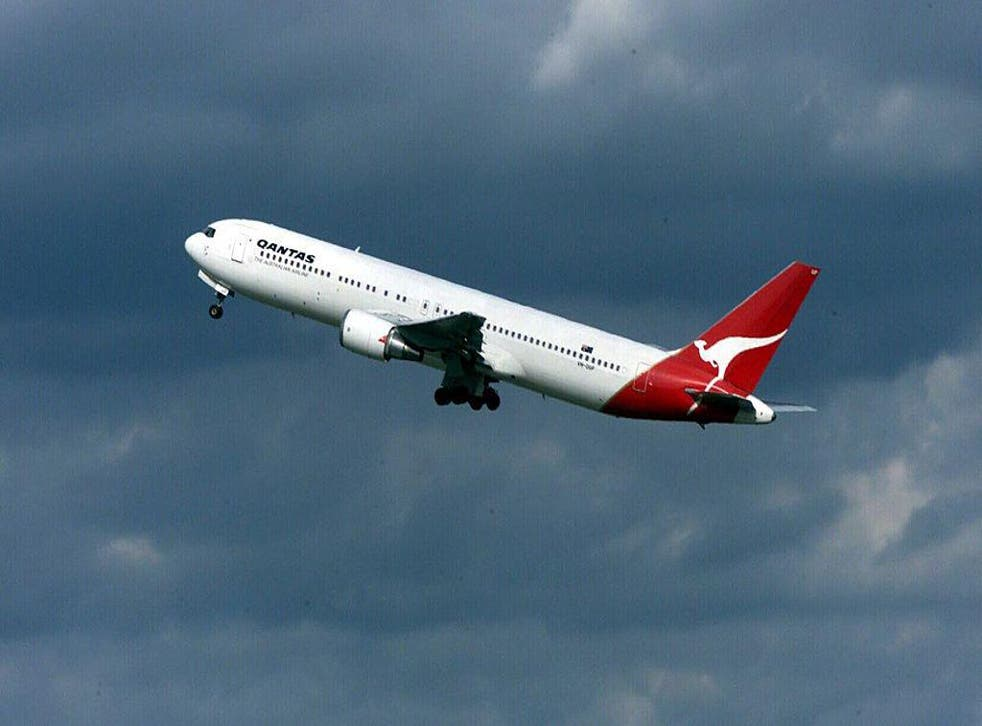 A Qantas Australia 767 jet takes off for Wellington at Auckland Airport