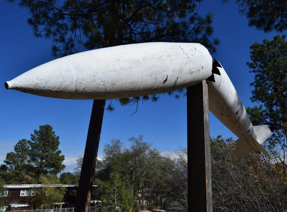 A sculpture of a bomb remains by the Black Hole of Los Alamos