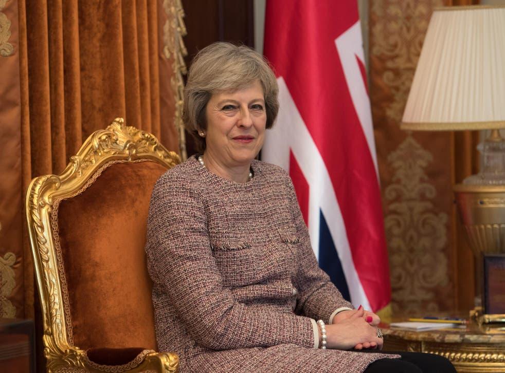 Theresa May looks on as she meets Sheikh Tamim bin Hamad Al Thani, the Emir of Qatar
