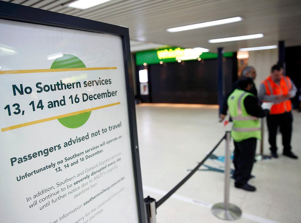 A board advises passengers of industrial action by Southern railway workers, at Victoria station in London
