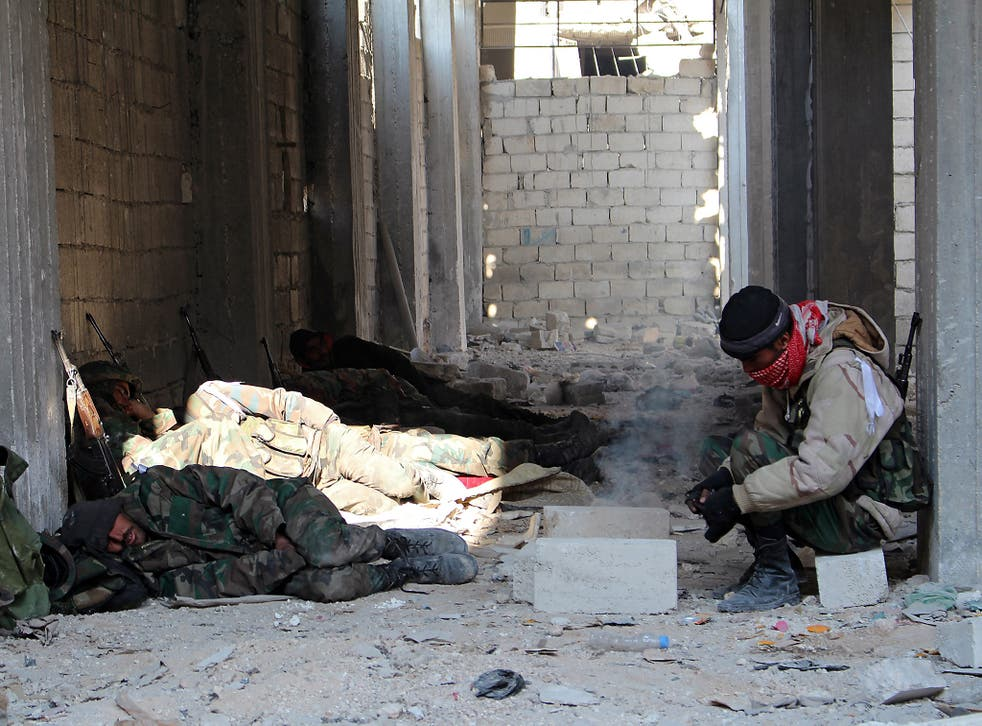 Syrian soldiers rest follow winning control of Sheik Saeed neighborhood in Aleppo, Syria, on December 12 2016