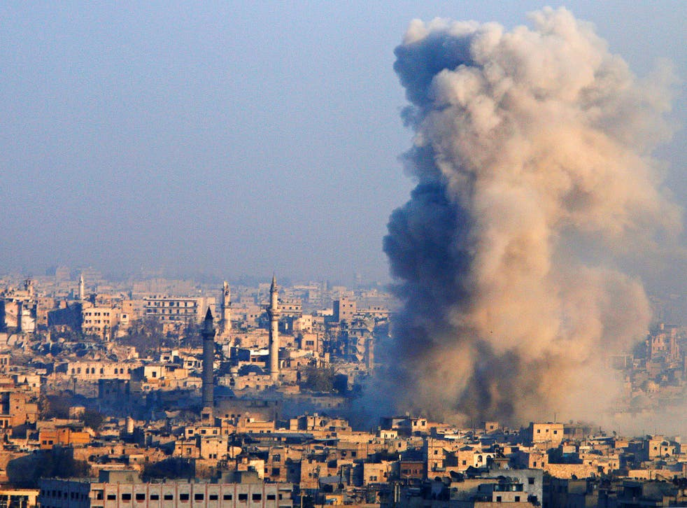 Smoke rises as seen from a governement-held area of Aleppo, Syria