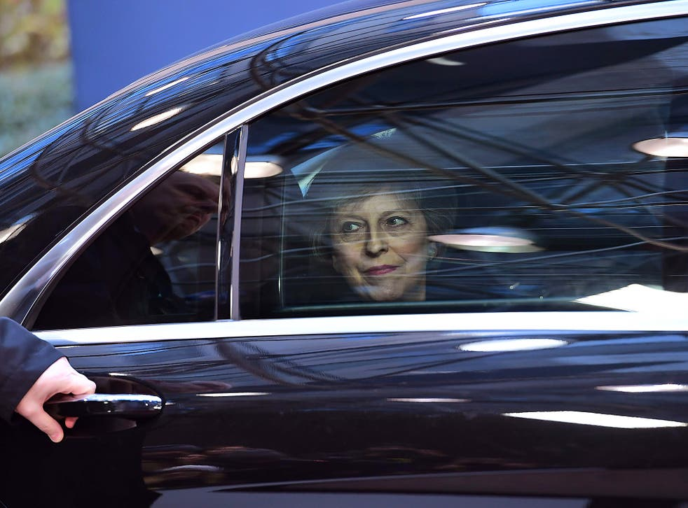 British Prime Minister Theresa May arrives for a European Union leaders summit focused on Russia sanctions and migration at the European Council in Brussels