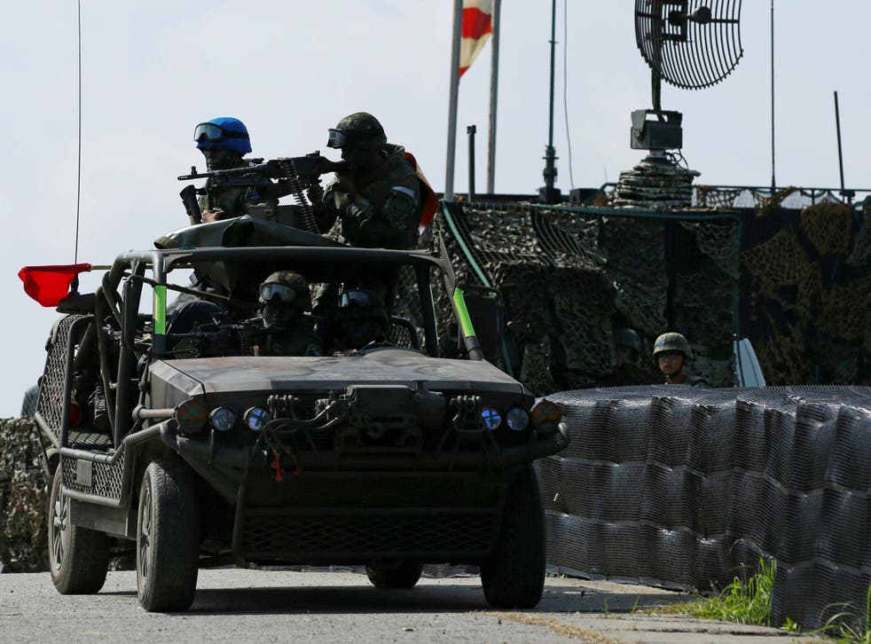 Military vehicle participating in drill simulating the China's People's Liberation Army invading Taiwan
