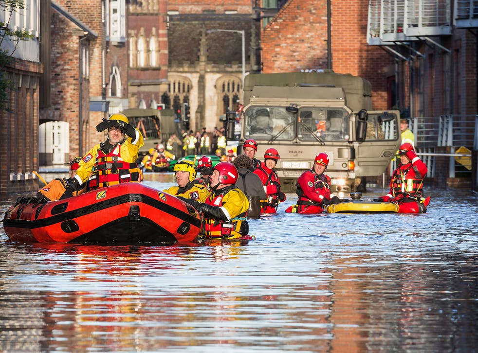 Rescue teams in York attend the scene of a flood in 2015