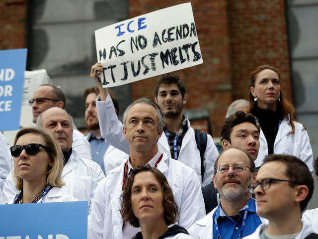Scientists hold a rally in support of research about climate change at an American Geophysical Union meeting in San Francisco