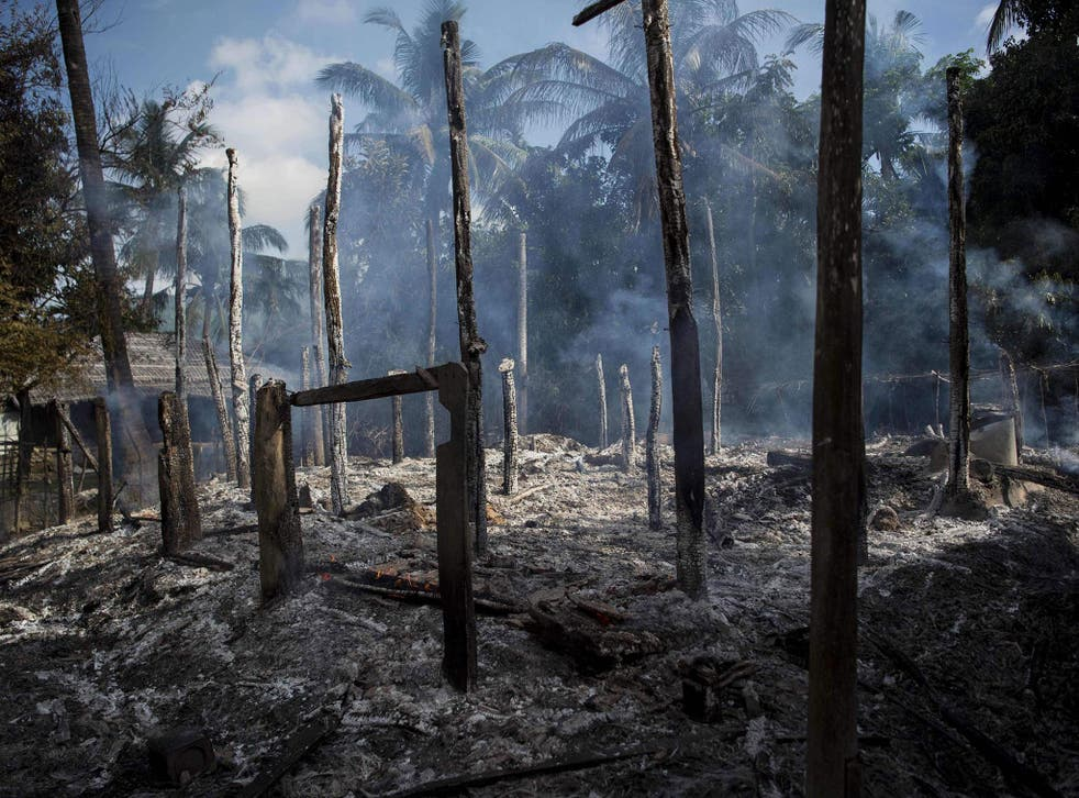 Smouldering debris of burned houses in Warpait village, a Muslim village in Maungdaw, Rakhine state, 14 October, 2016