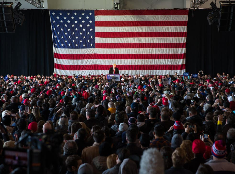 Donald Trump speaks in front of a capacity crowd at a rally for his campaign in Rochester, New York