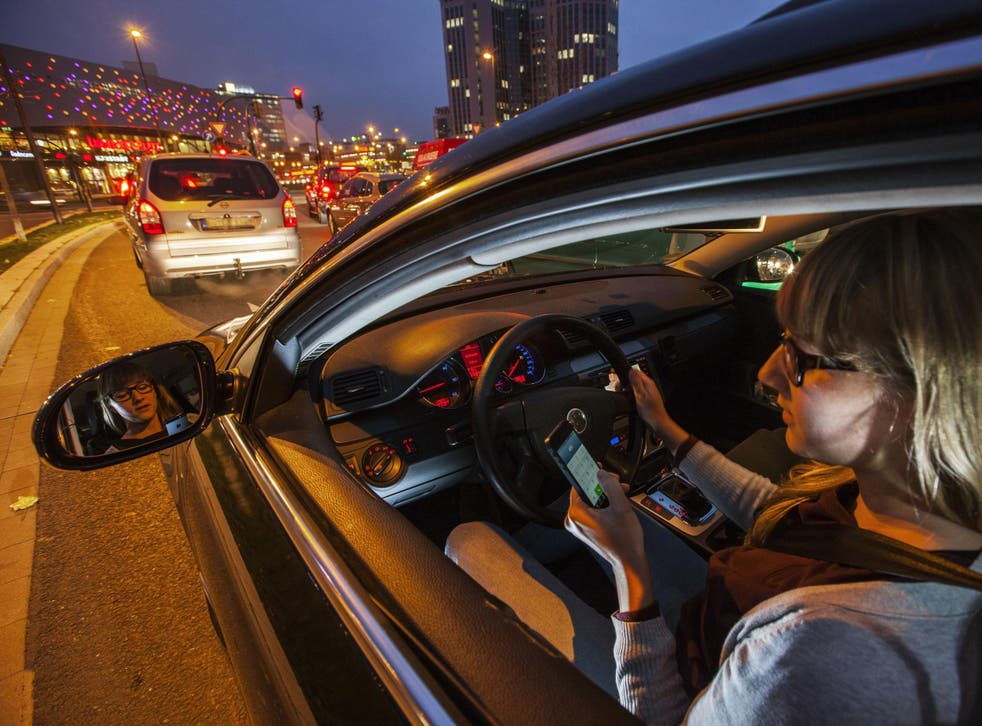 Almost one in three drivers admit to having used their phone at the wheel in the past year