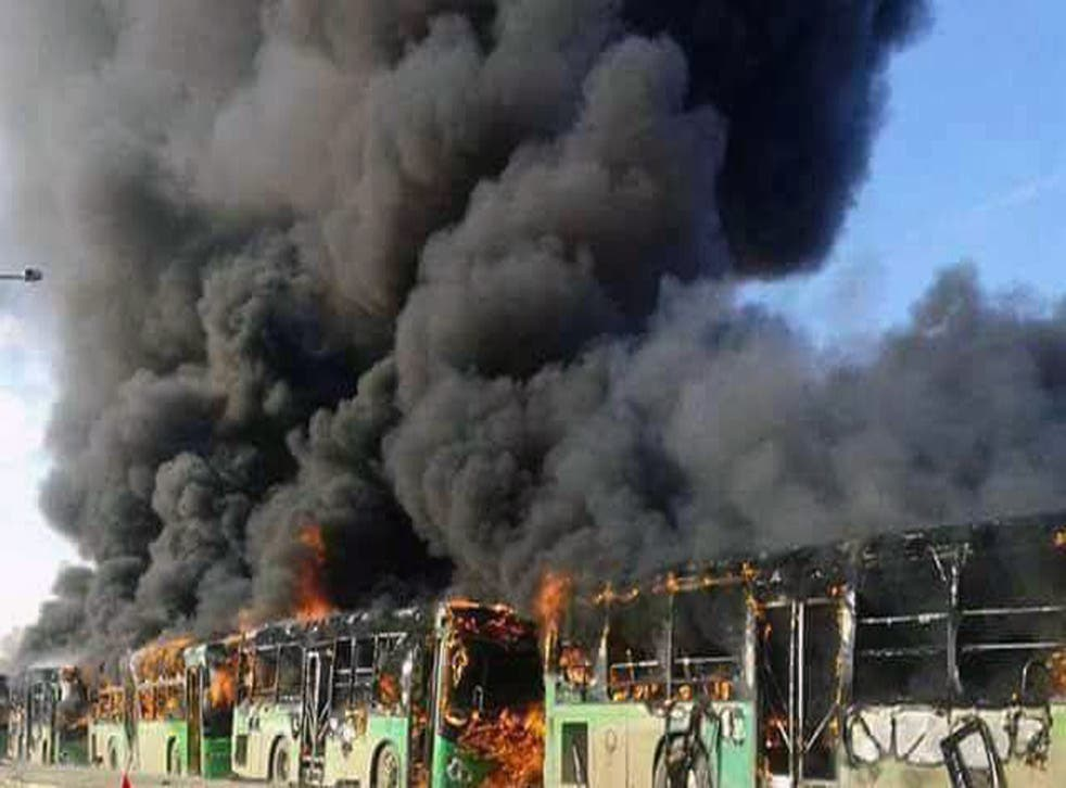Syrian activists said militants have burned at least five buses assigned to evacuate wounded and sick people