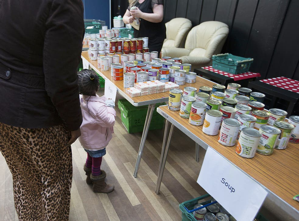 People collecting food from a food bank
