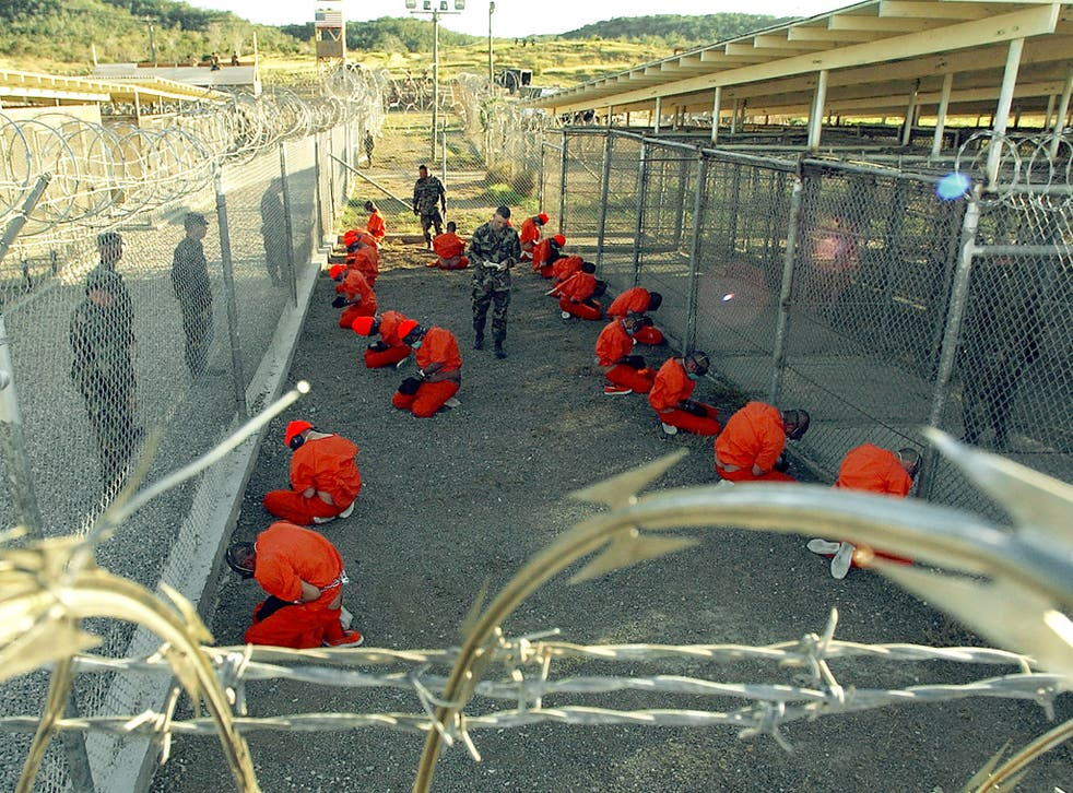 This photo shows hooded inmates at the Guantanamo Bay prison, where both men are being held
