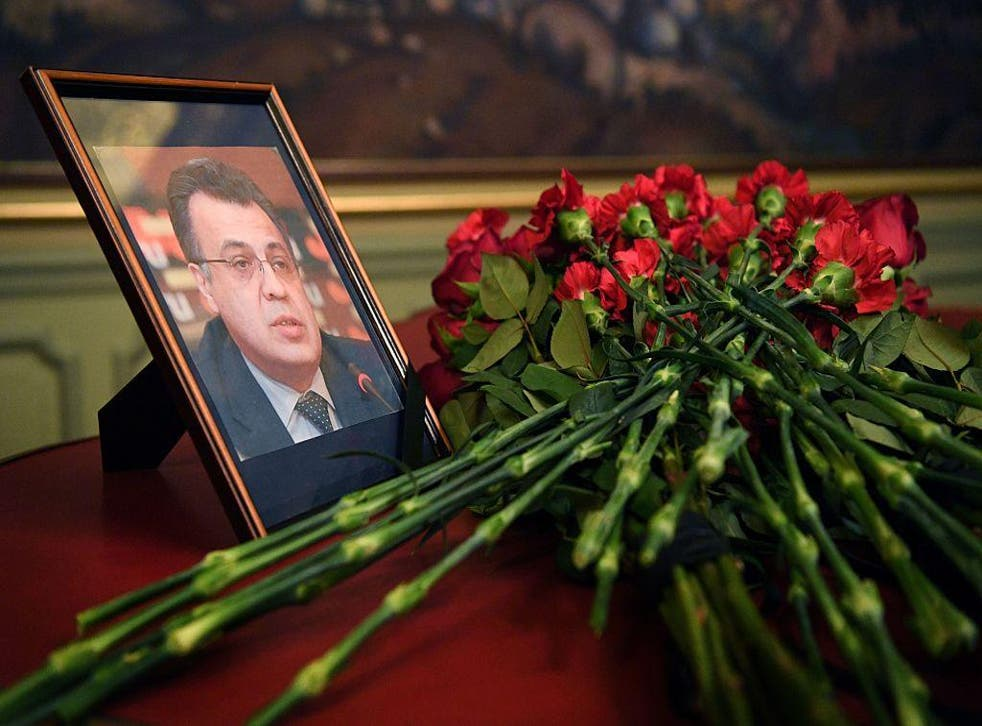 lowers are placed in front of a portrait of Russian Ambassador to Turkey Andrei Karlov in the Foreign Ministry in Moscow on December 20, 2016, a day after he was assassinated