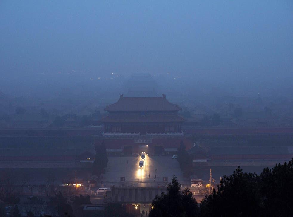 The Forbidden City is seen through heavy air pollution in Beijing