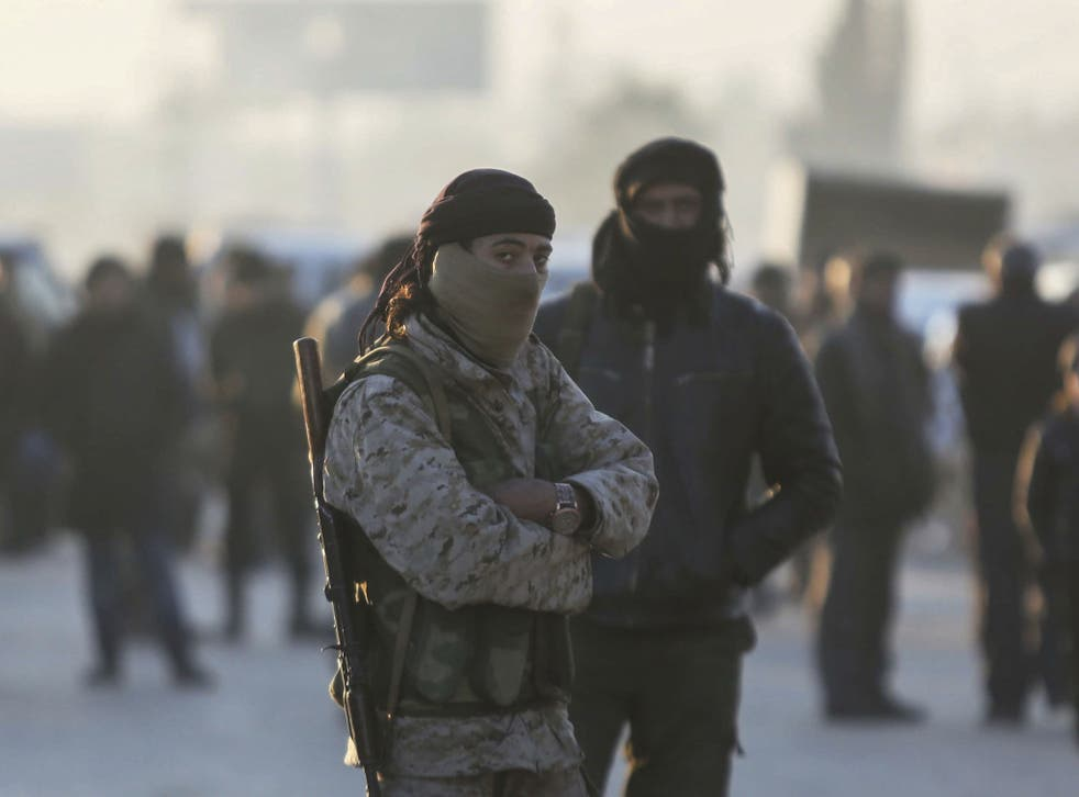 Armed Syrian fighters evacuated from Aleppo arrive at a refugee camp in Rashidin, near Idlib