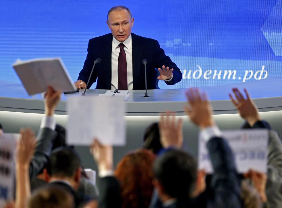 Vladimir Putin fields questions during his annual press conference in Moscow