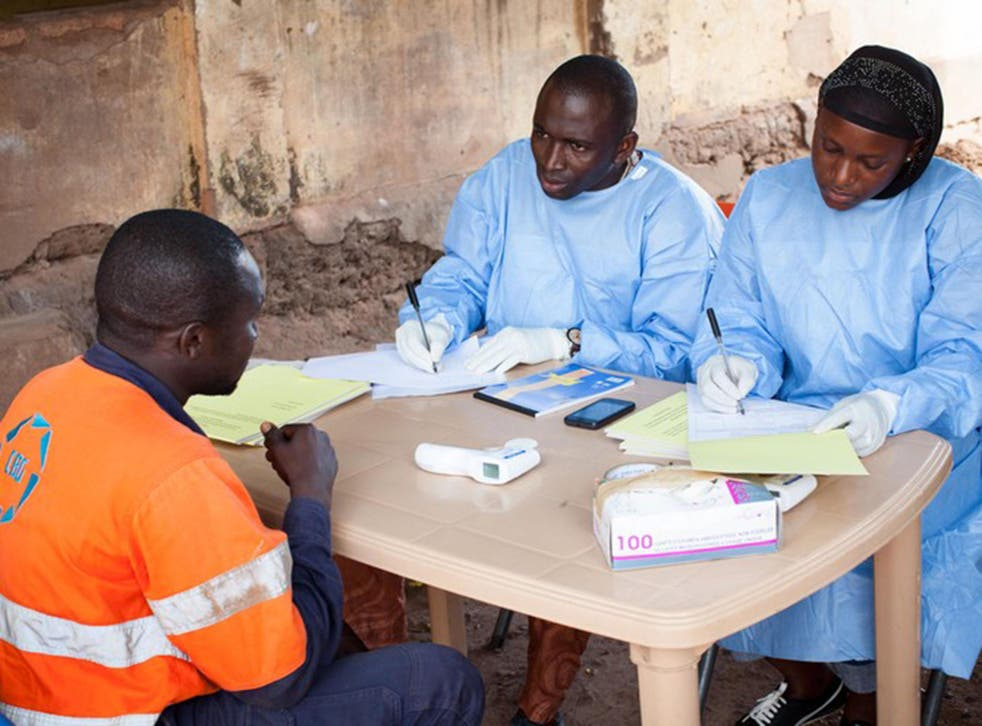 Health officials process samples in the Ebola lab at Donka Hospital in Conakry, Guinea