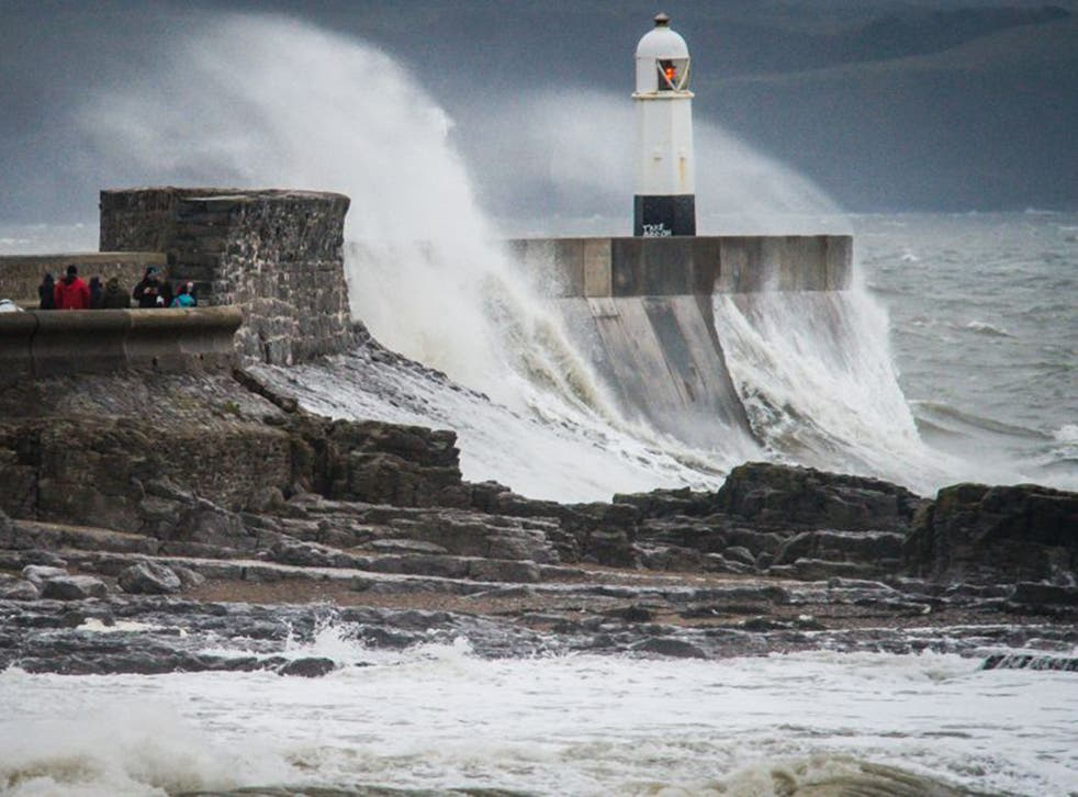 Waves crash over the harbour wall at Porthcawl during Storm Barbara