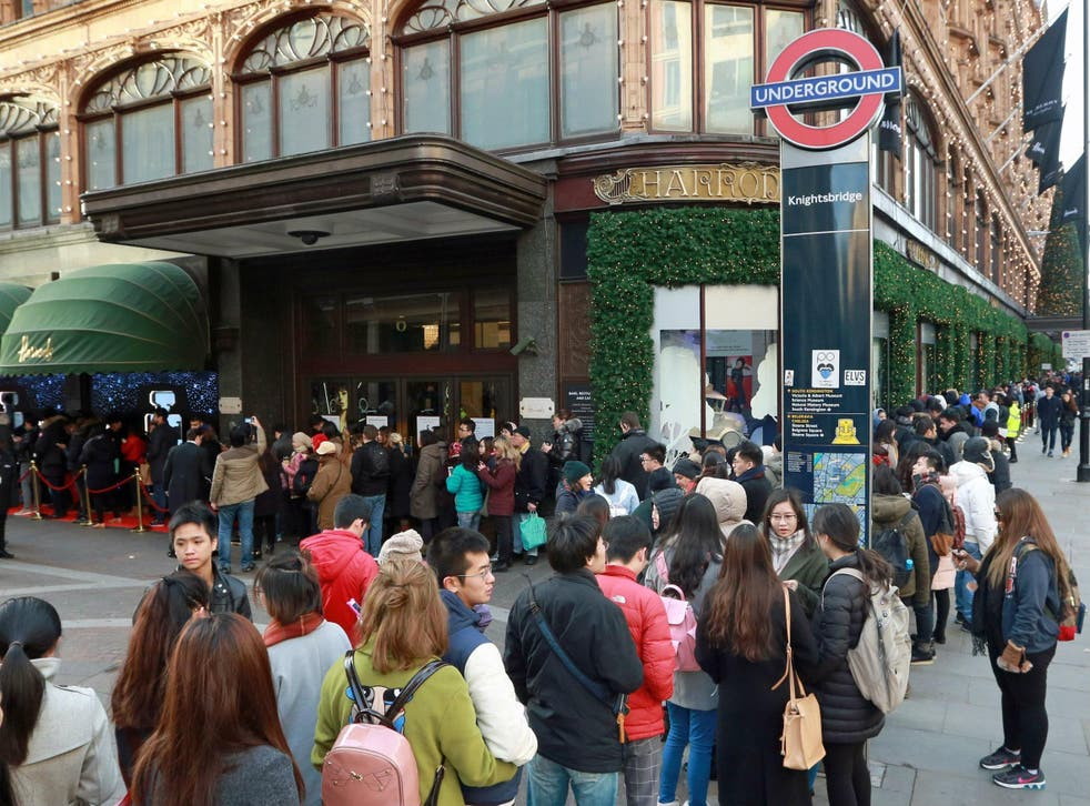 Customers queue outside Harrods in Knightsbridge, London, in preparation of the Boxing Day Sale