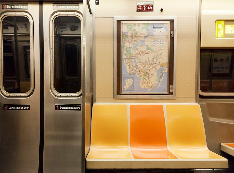 New York, NY, USA - March 15, 2016: Inside of subway wagon: Colorful seats and inside of empty car: The NYC Subway is one of the oldest and most extensive public transportation systems in the world.