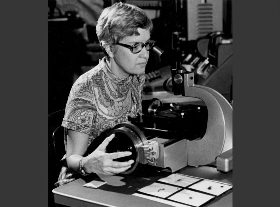 In this image taken in the 1970s and provided by the Carnegie Institution of Washington, Vera Rubin uses a measuring engine