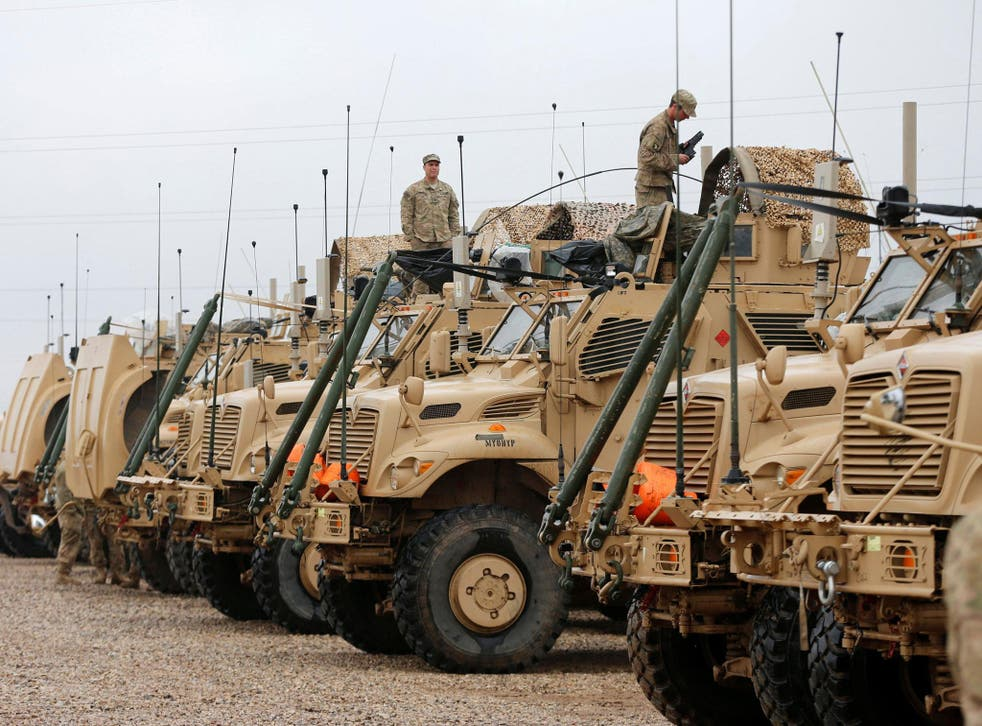 US troops, who are supporting the Iraqi millitary, gather east of Mosul
