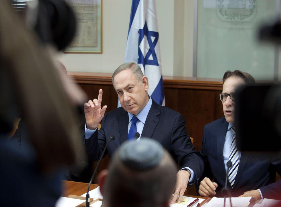 Israeli Prime Minister Benjamin Netanyahu chairs the weekly cabinet meeting in Jerusalem on December 25, 2016. Israel was defiant over a UN vote demanding it halt settlements in Palestinian territory, after lashing out at US President Barack Obama over the 'shameful' resolution