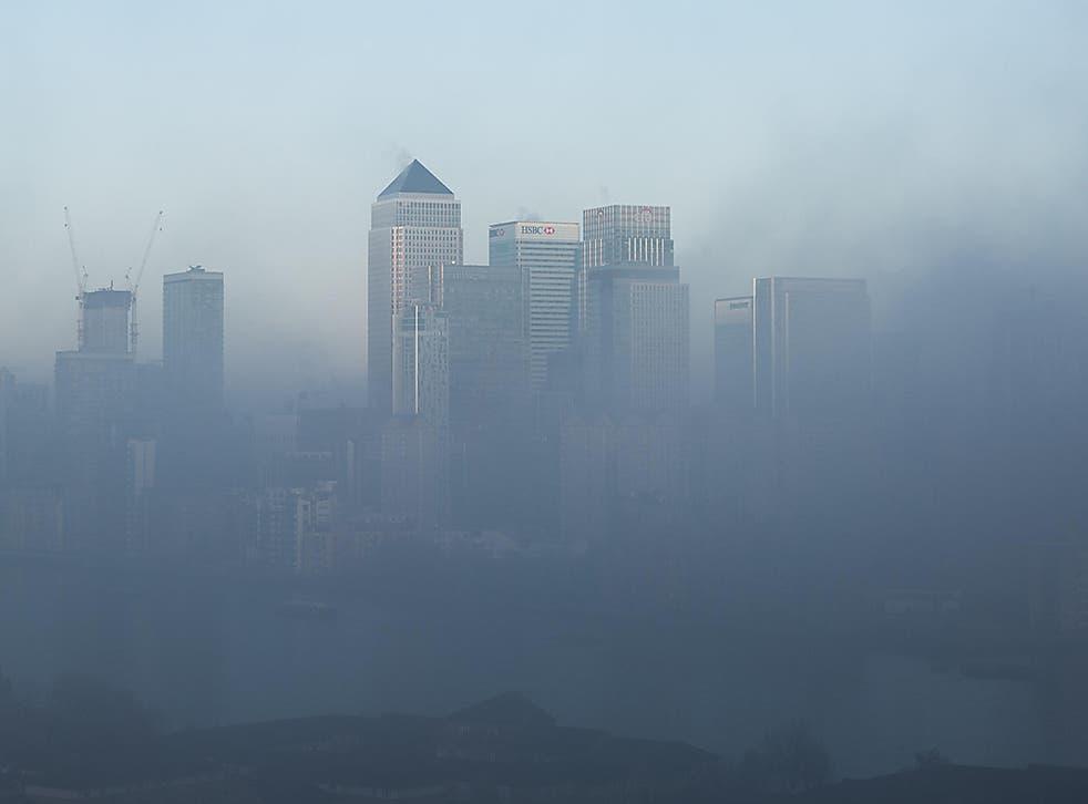 Heavy fog clouds over Canary Wharf