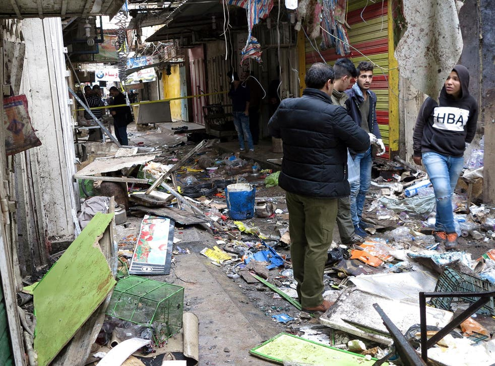 Twin attacks claimed by Isis in Baghdad on New Year's Eve killed 24 people