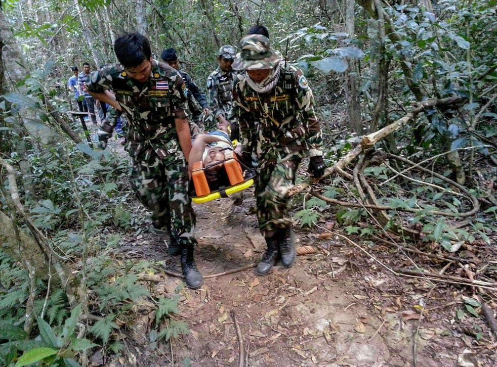 Muriel Benetulier is transported on a stretcher by Thai Park Rangers after she was bitten by after she was bitten by a crocodile