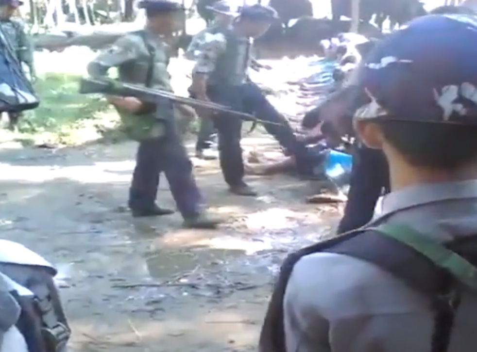 Burmese authorities detain several police after a video emerged of officers beating Rohingya Muslims during a security operation