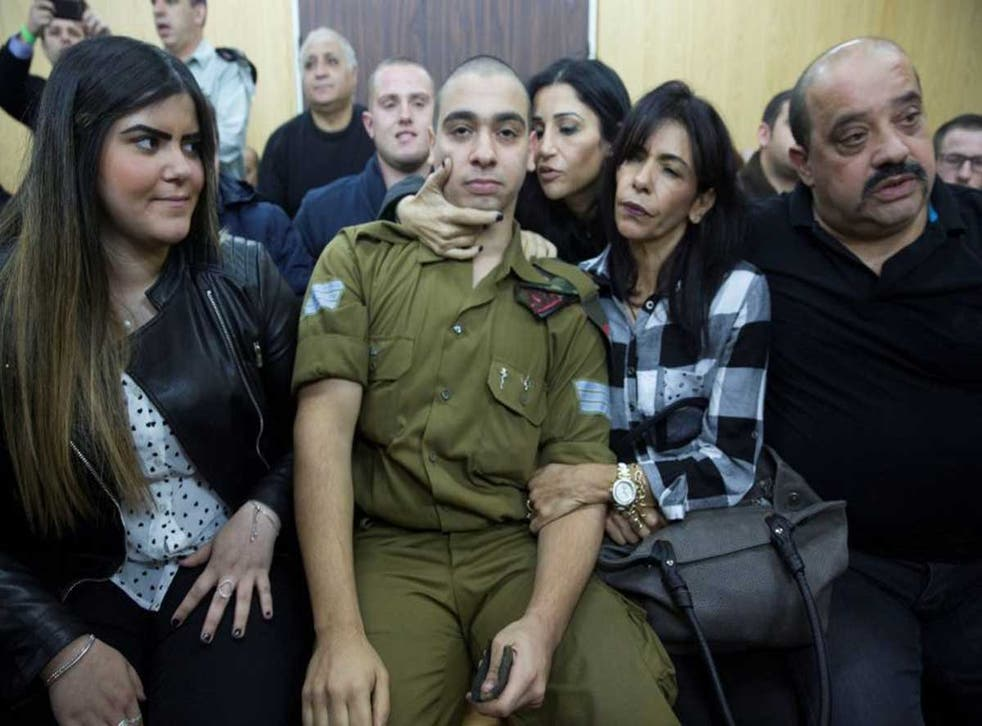 Elor Azaria with his family in court (Reuters)