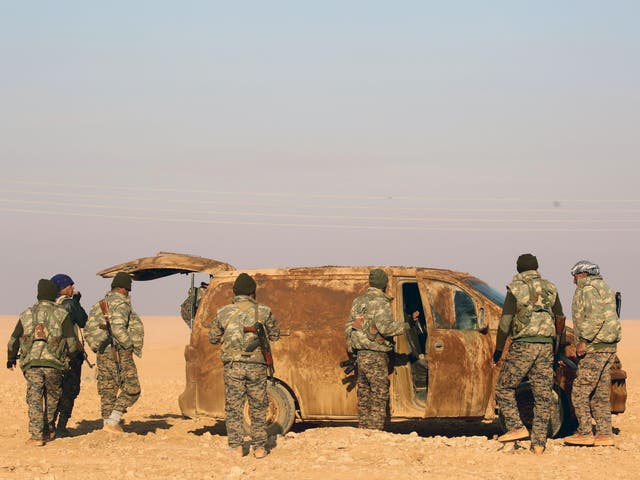 Fighters from the Kurdish-Arab alliance, known as the Syrian Democratic Forces, near the Syrian village of al-Naseem on the western outskirts of the Isis bastion of Raqqa