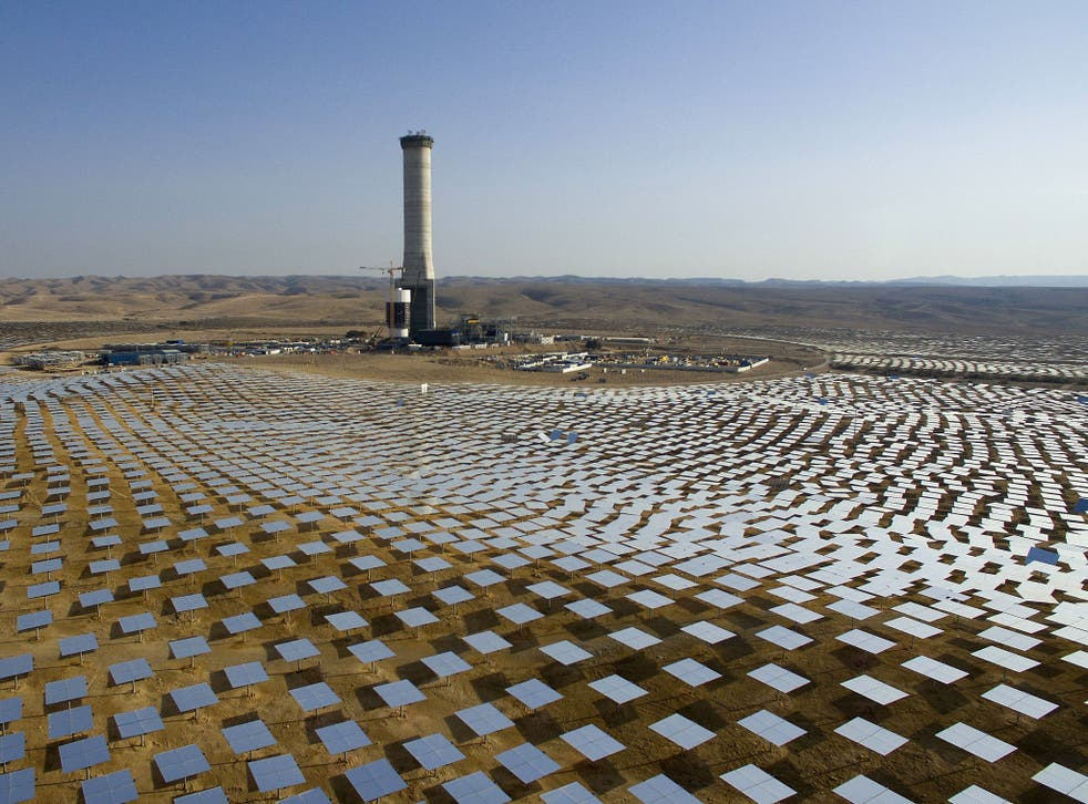 In this 22 December 2016 photo, 50,000 mirrors - known as heliostats - encircle the solar tower in the Negev desert, near in Ashelim, southern Israel