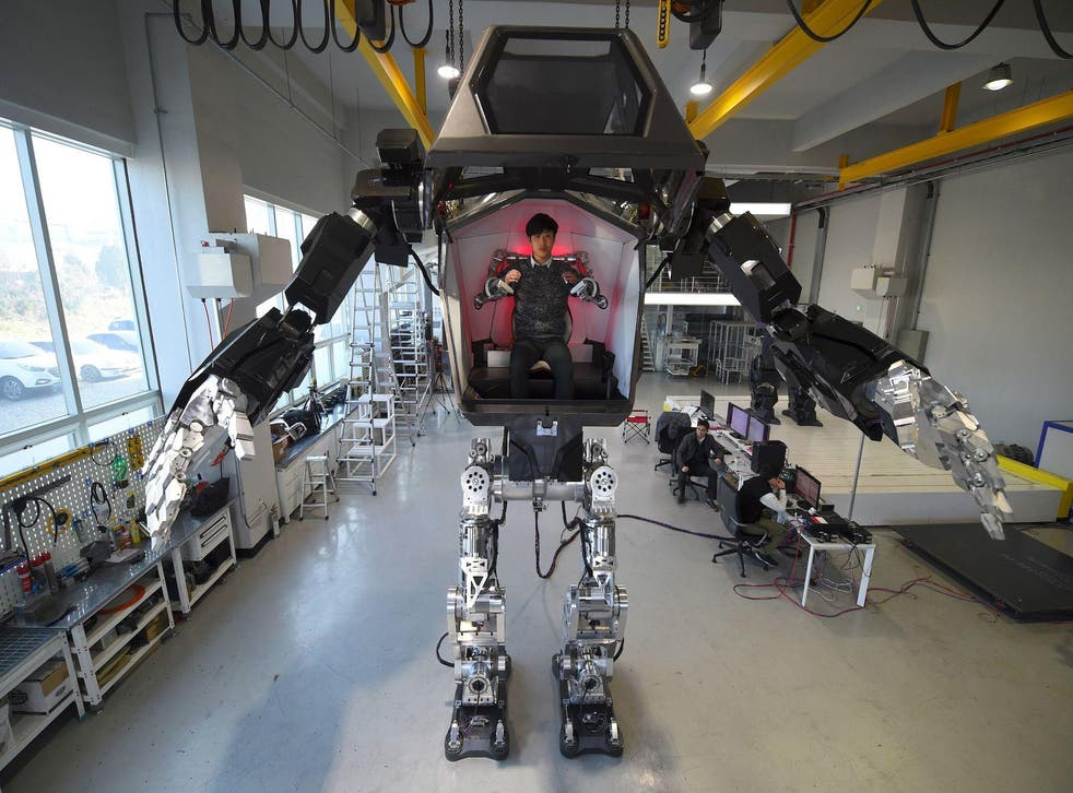 Engineers test a four-metre-tall humanoid manned robot dubbed Method-2 in a lab of the Hankook Mirae Technology in Gunpo, south of Seoul, on December 27, 2016
