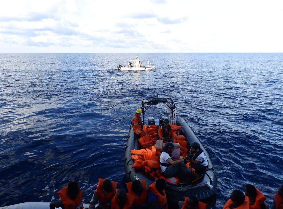 A Libyan coastguard boat observing a rescue by MSF's Bourbon Argos ship on 4 November 2016
