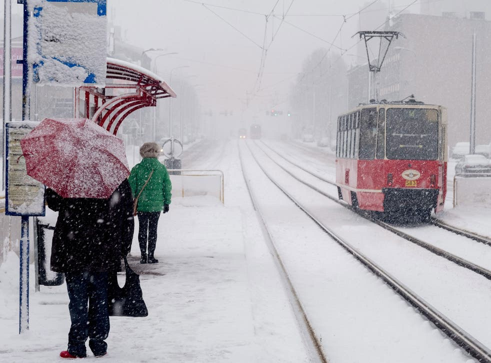 Pedestrians making their way during a heavy snowfall in Katowice, Silesia, southern Poland, 04 January 2017.