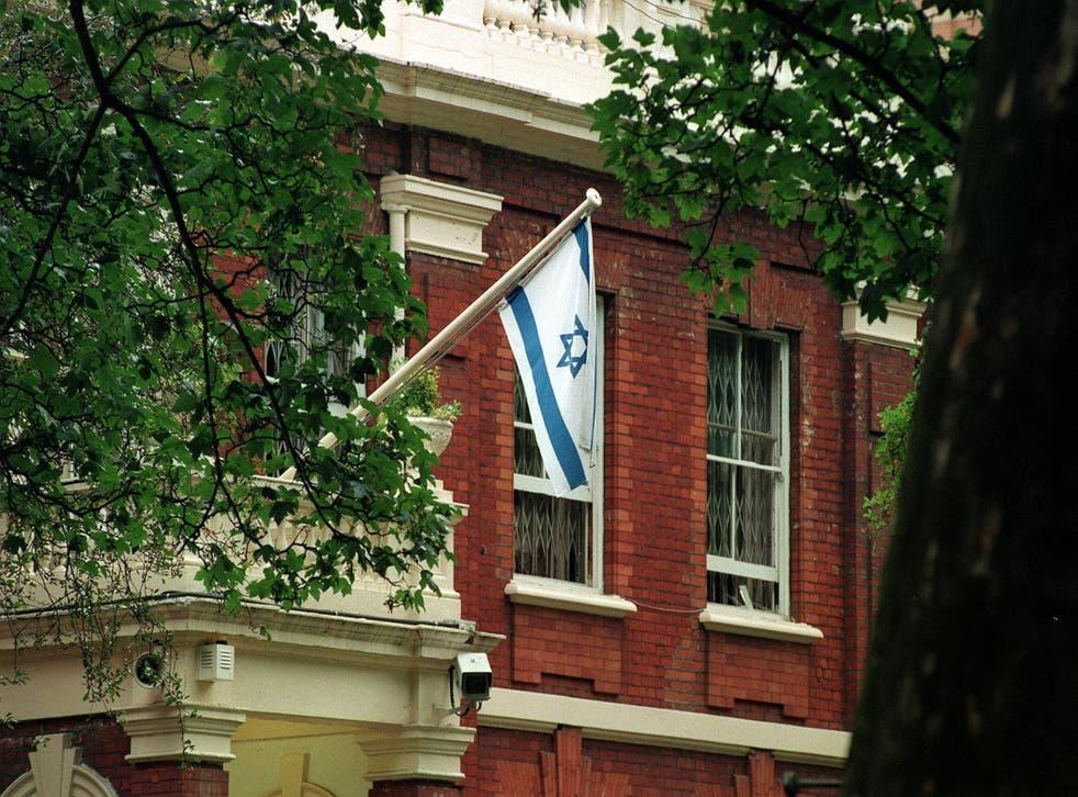An Israeli flag flies at the Israeli Embassy in Kensington