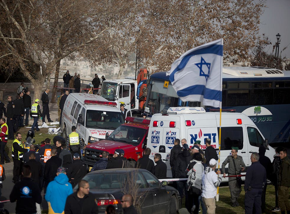 Israeli security forces and emergency services gather at the site of a vehicle-ramming attack on 8 January in Jerusalem. Four israeli soldiers were killed and 13 wounded in the attack
