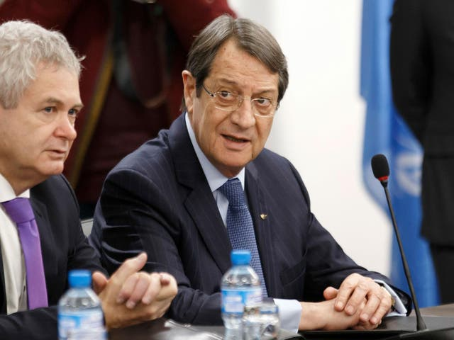 Greek Cypriot President Nicos Anastasiades, right, waits for the start of a new round of Cyprus peace talks