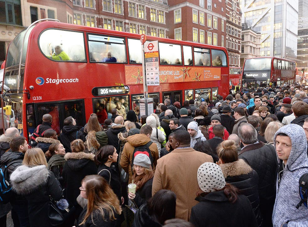 People queue for buses at Bishopsgate in the City of London, as Underground workers in the capital continued a 24-hour strike
