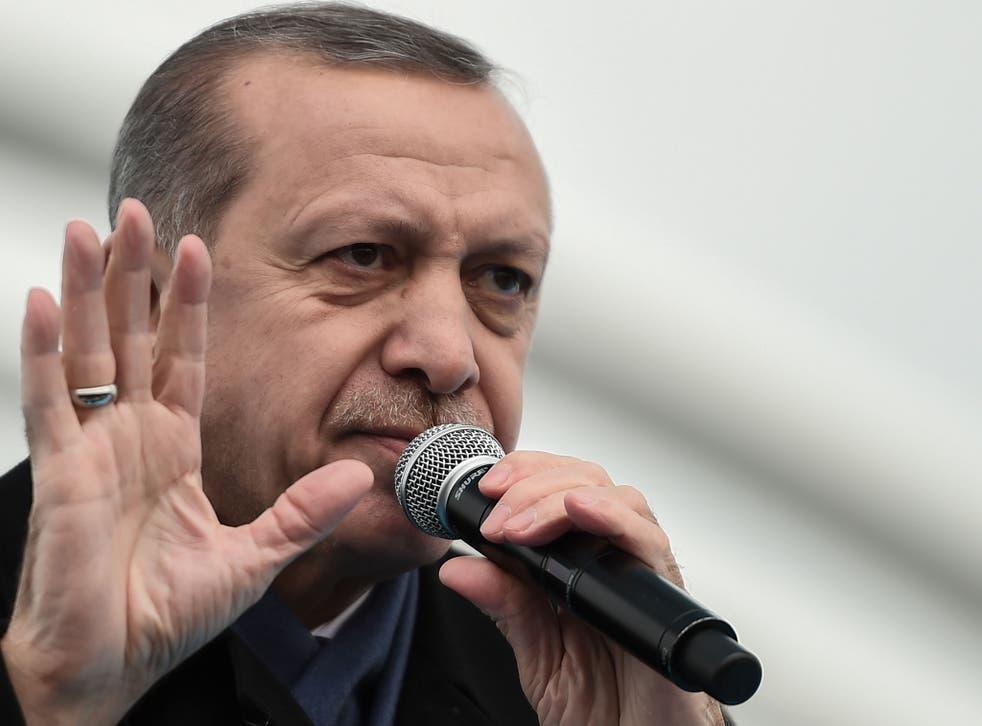 Turkish President Recep Tayyip Erdogan delivers a speech on December 20, 2016 in Istanbul Getty